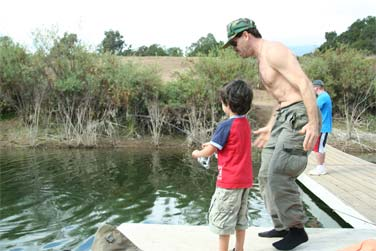 The youngest angler and member of the Ojai Valley Whale Society, Rio shows off his stuff and reels in a two pound trout! In utter excitement, Aaron dances a jig as Rio angles in the lunker trout from the deep